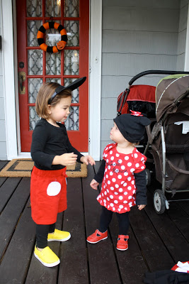 Toddlers in mickey and minnie mouse costumes