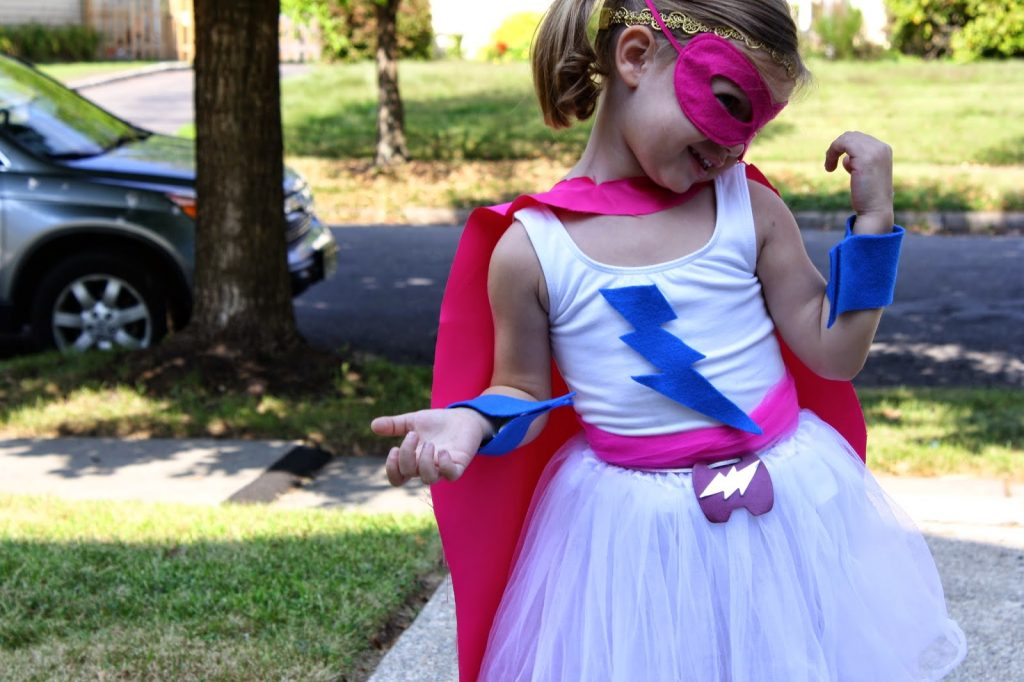 Cape Use one you have or follow directions below on how to make one. You will need about 1/2 yard of the fabric of your choice. & DIY Super Hero Costume For Girls - The Chirping Moms