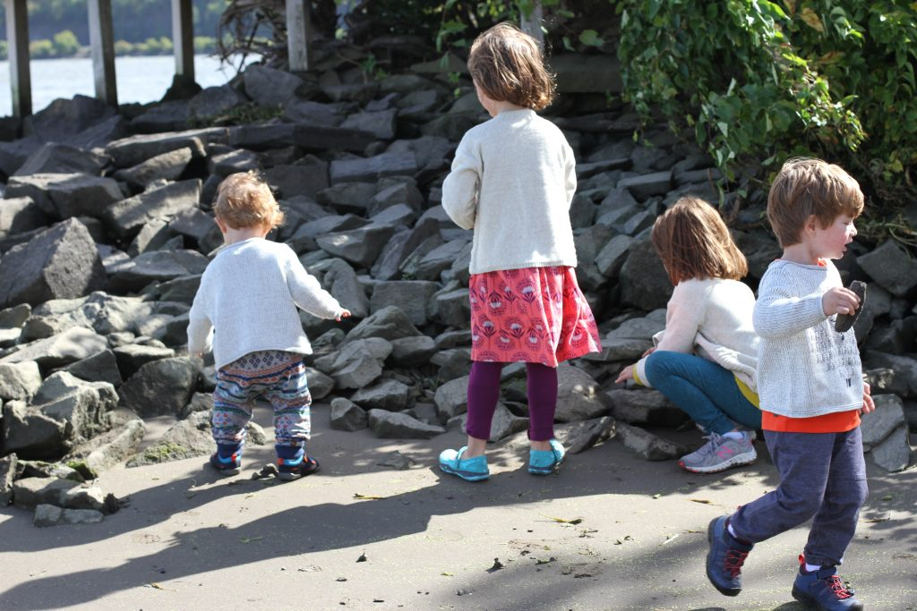 Kids playing and rocks at Saugerties Lighthouse